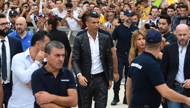 Cristiano Ronaldo was greeted by a large crowd of cheering fans as he  arrived at Juventus  medical centre to complete his move from Real Madrid. 85b0a39b8