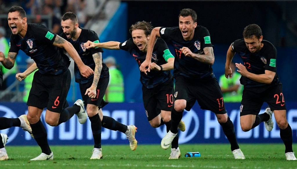Croatia's players celebrate after Ivan Rakitic's penalty sent them into the World Cup semi-finals.