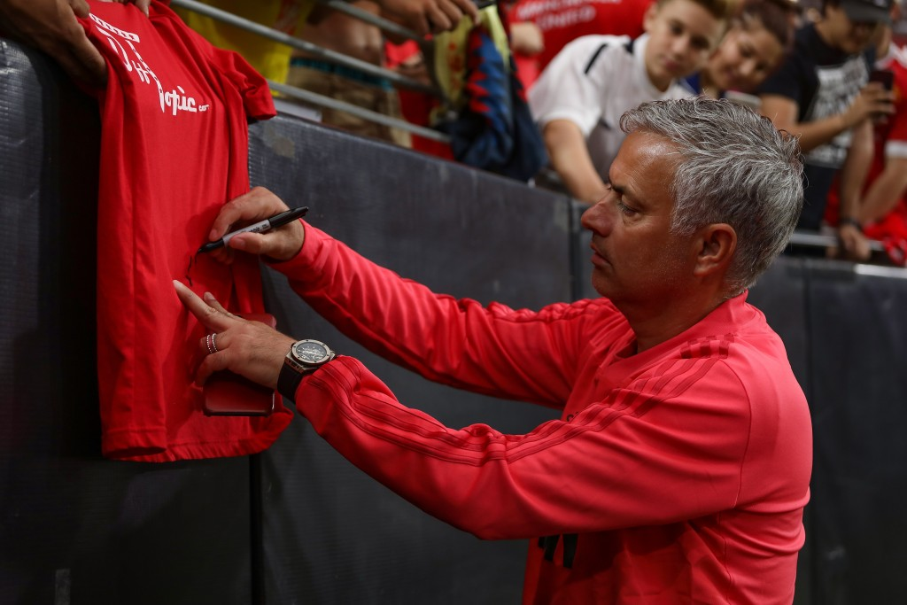 GLENDALE, AZ - JULY 19:  Manchester United manager Jose Mourinho signs an autograph prior to the International Champions Cup game against Club America at the University of Phoenix Stadium on July 19, 2018 in Glendale, Arizona.  (Photo by Christian Petersen/Getty Images for International Champions Cup)