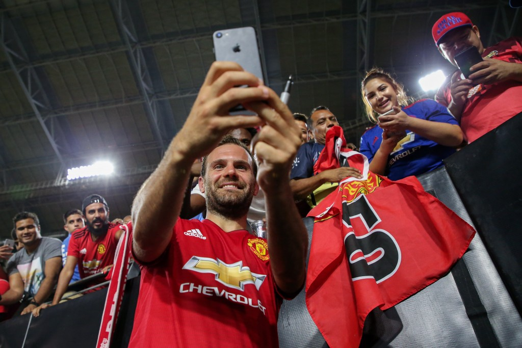 GLENDALE, AZ - JULY 19: Juan Mata #8 of Manchester United takes photos with fans after International Champions Cup game against the Club America at the University of Phoenix Stadium on July 19, 2018 in Glendale, Arizona. (Photo by Christian Petersen/Getty Images for International Champions Cup)