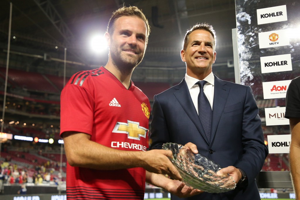 GLENDALE, AZ - JULY 19: Juan Mata #8 of Manchester United poses with Karger David Kohler President and CEO of Kohler Company after the International Champions Cup game against the Club America at the University of Phoenix Stadium on July 19, 2018 in Glendale, Arizona. (Photo by Christian Petersen/Getty Images for International Champions Cup)