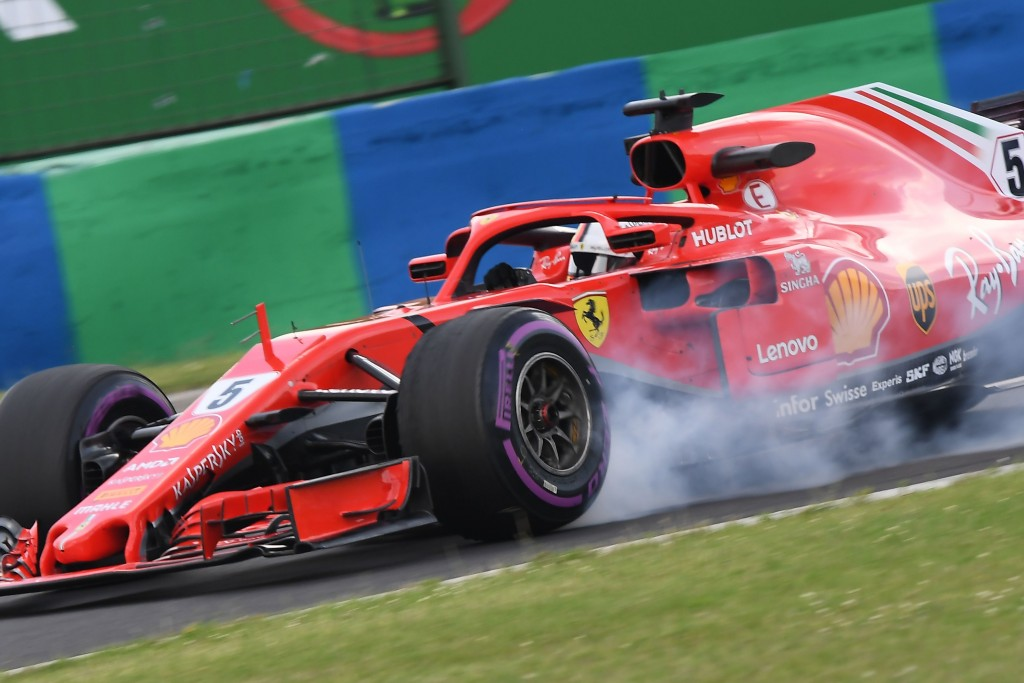 Ferrari's German driver Sebastian Vettel steers his car during the practice session of the Formula One Hungarian Grand Prix at the Hungaroring circuit in Mogyorod near Budapest, Hungary, on July 27, 2018. (Photo by ATTILA KISBENEDEK / AFP) (Photo credit should read ATTILA KISBENEDEK/AFP/Getty Images)