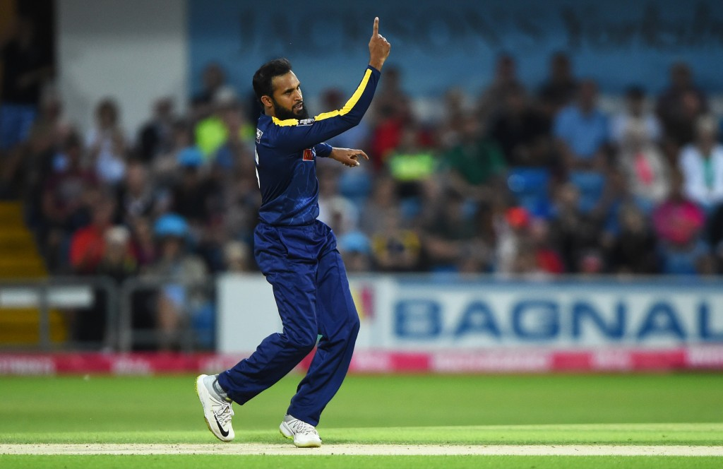 LEEDS, ENGLAND - JULY 27: Adil Rashid of Yorkshire celebrates as he gets Sam Hain of Birmingham out during the Vitality Blast match between Yorkshire Vikings and Birmingham Bears at Headingley on July 27, 2018 in Leeds, England. (Photo by Nathan Stirk/Getty Images)