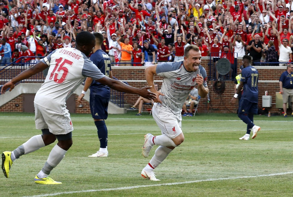 Liverpool FC Xherdan Shaqiri (R) celebrates after scoring against the Manchester United during the second half of their 2018 International Champions Cup football match at Michigan Stadium in Ann Arbor, Michigan on July 28, 2018. - Liverpool FC beat Manchester United 4-1 in their friendly. (Photo by JEFF KOWALSKY / AFP) (Photo credit should read JEFF KOWALSKY/AFP/Getty Images)