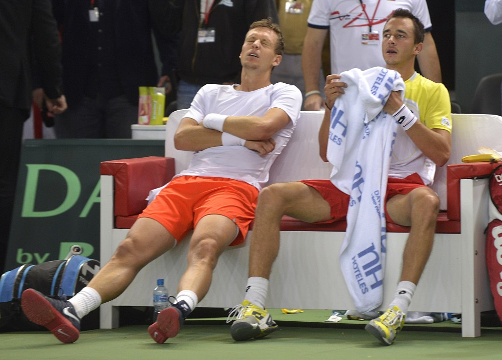 Czech pair Tomas Berdych (L) and Lukas Rosol react after defeating Swiss player Stanislas Wawrinka and Marco Chiudinelli in the Davis Cup first round match, on February 2, 2013 in Geneva. The Czech Republic's Tomas Berdych and Lukas Rosol defeated Stanislas Wawrinka and Marco Chiudinelli of Switzerland 6-4, 5-7, 6-4, 6-7 (3/7), 24-22 in the longest Davis Cup rubber of all time. AFP PHOTO / SEBASTIEN FEVAL (Photo credit should read SEBASTIEN FEVAL/AFP/Getty Images)