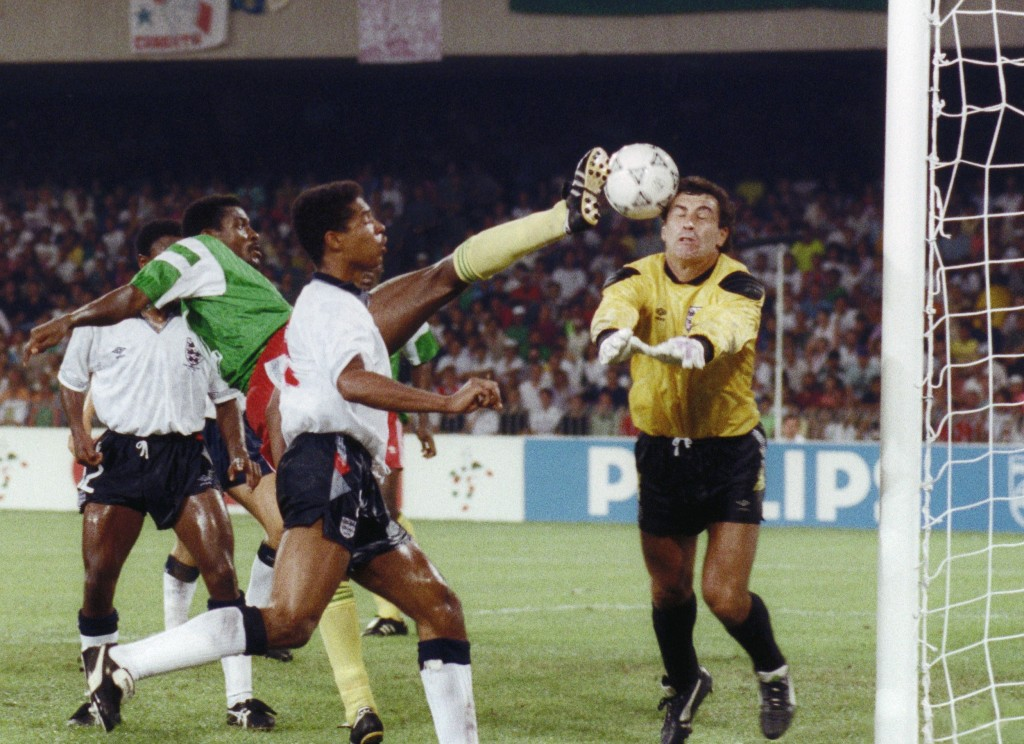 Cameroon's forward Frantois Omam Biyik (L) tries t