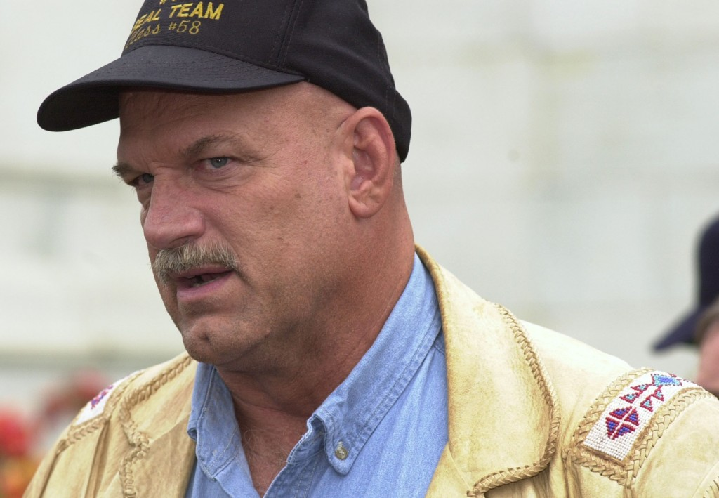 WASHINGTON, DC - SEPTEMBER 19: Minnesota Gov. Jesse Ventura talks with other officials prior to speaking at a rally for campaign fund reform on the steps of the US Capital in Washington, DC. (Photo credit should read DON WRIGHT/AFP/Getty Images)