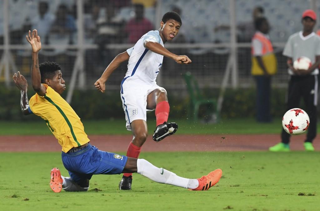 Rhian Brewster(L) of England kicks the ball during the semifinal football match in the FIFA U-17 World Cup at the Vivekananda Yuba Bharati Krirangan stadium in Kolkata on October 25, 2017. / AFP PHOTO / Dibyangshu SARKAR (Photo credit should read DIBYANGSHU SARKAR/AFP/Getty Images)
