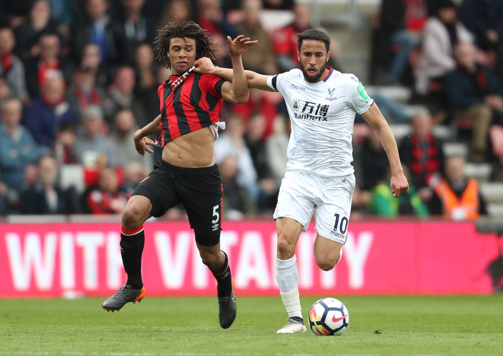 BOURNEMOUTH, ENGLAND - APRIL 07: Nathan Ake of AFC Bournemouth is challenged by Andros Townsend of Crystal Palace during the Premier League match between AFC Bournemouth and Crystal Palace at Vitality Stadium on April 7, 2018 in Bournemouth, England. (Photo by Christopher Lee/Getty Images)