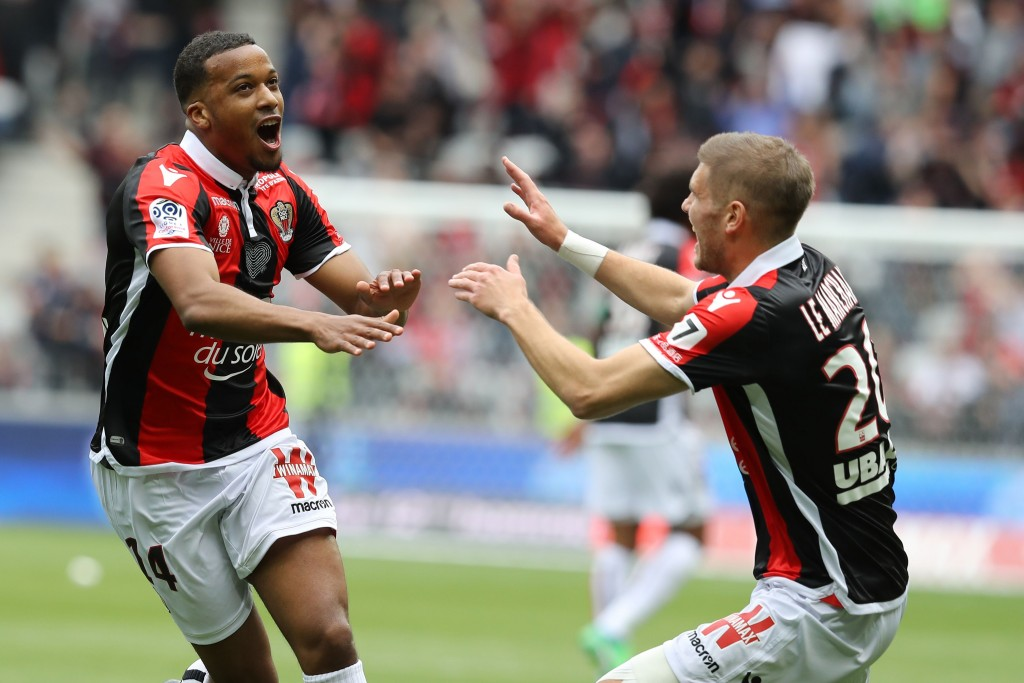 "Nice's French forward Alassane Plea (L) celebrates after scoring a goal during the French L1 football match Nice vs Rennes on april 8, 2018 at the ""Allianz Riviera"" stadium in Nice, southeastern France. / AFP PHOTO / VALERY HACHE (Photo credit should read VALERY HACHE/AFP/Getty Images)"
