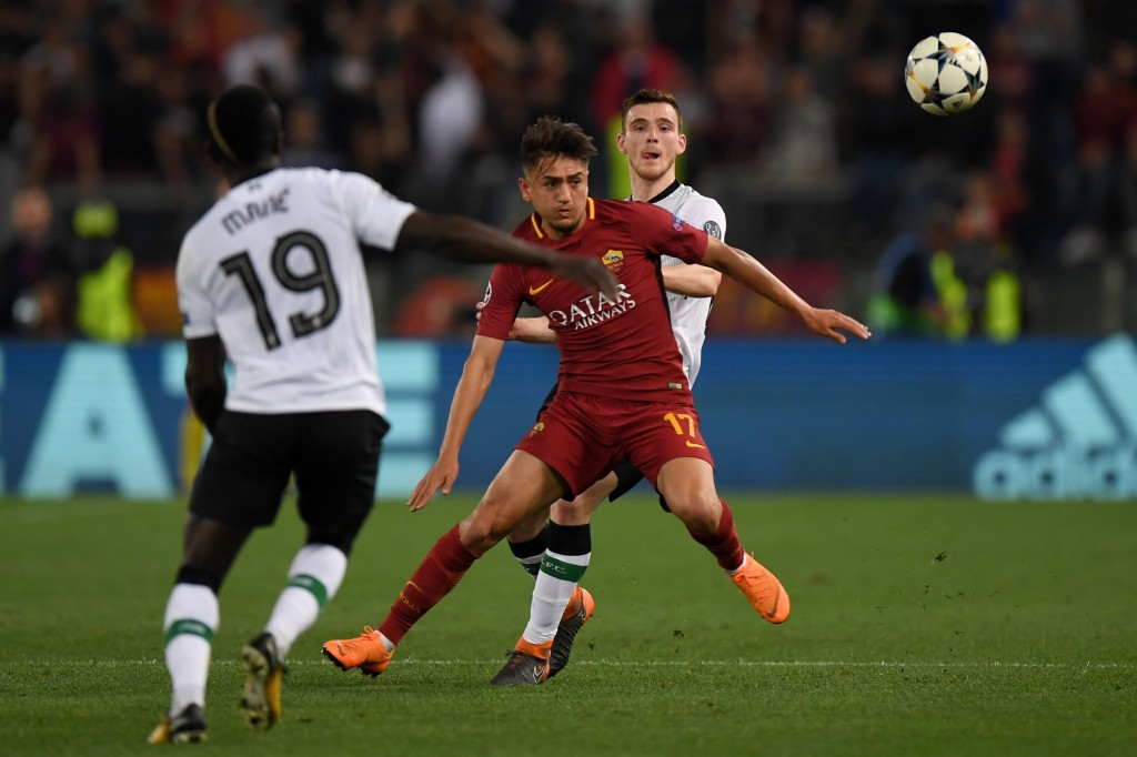Roma's Turkish midfielder Cengiz Under (C) vies with Liverpool's Senegalese midfielder Sadio Mane (L) and Liverpool's Scottish defender Andrew Robertson during the UEFA Champions League semi-final second leg football match between AS Roma and Liverpool at the Olympic Stadium in Rome on May 2, 2018. (Photo by Paul ELLIS / AFP) (Photo credit should read PAUL ELLIS/AFP/Getty Images)
