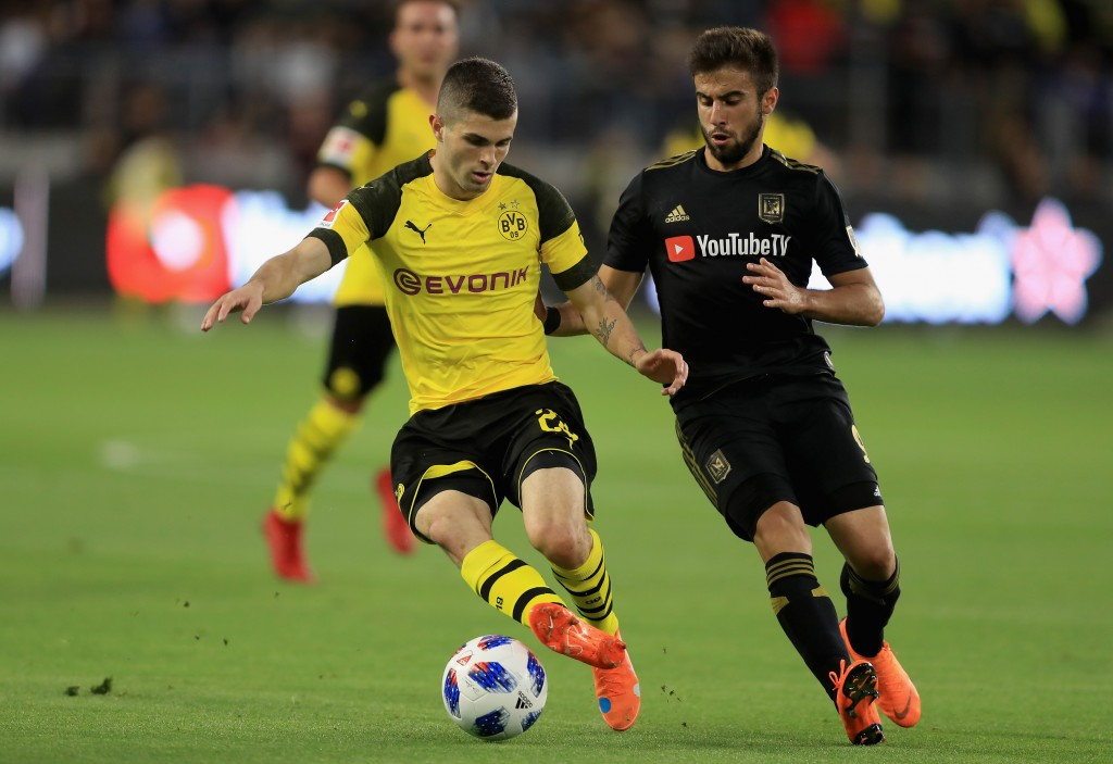 Christian Pulisic (l) has admirers in Germany, Spain and England