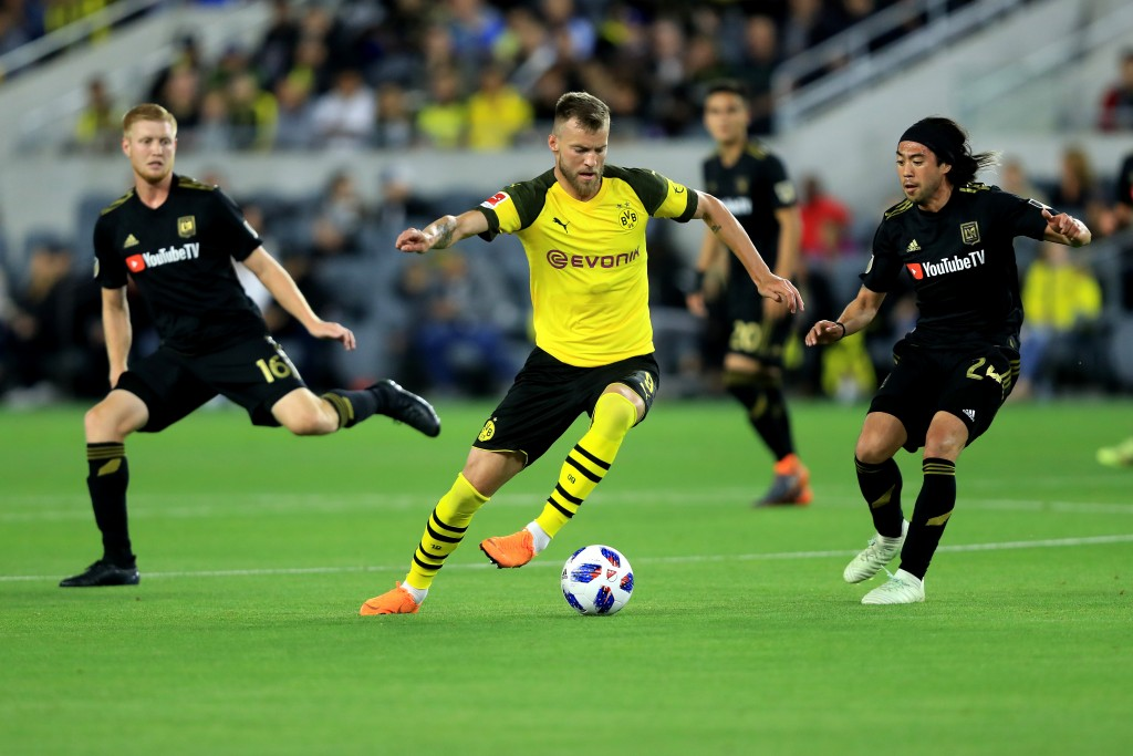 LOS ANGELES, CA - MAY 22: Calum Mallace #16 and Lee Nguyen #24 of Los Angeles FC defend against Andriy Yarmolenko #9 of Borussia Dortmund during the second half of an International friendly soccer match at Banc of California Stadium on May 22, 2018 in Los Angeles, California. (Photo by Sean M. Haffey/Getty Images)
