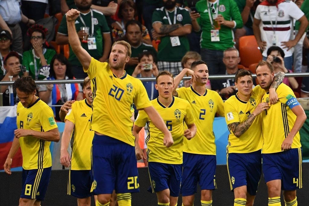 Andreas Granqvist (r) celebrates with his team-mates.
