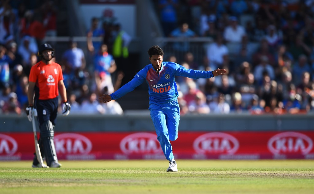 MANCHESTER, ENGLAND - JULY 03: Kuldeep Yadav of India celebrates getting Joe Root of England out during the 1st Vitality International T20 match between England and India at Emirates Old Trafford on July 3, 2018 in Manchester, England. (Photo by Nathan Stirk/Getty Images)