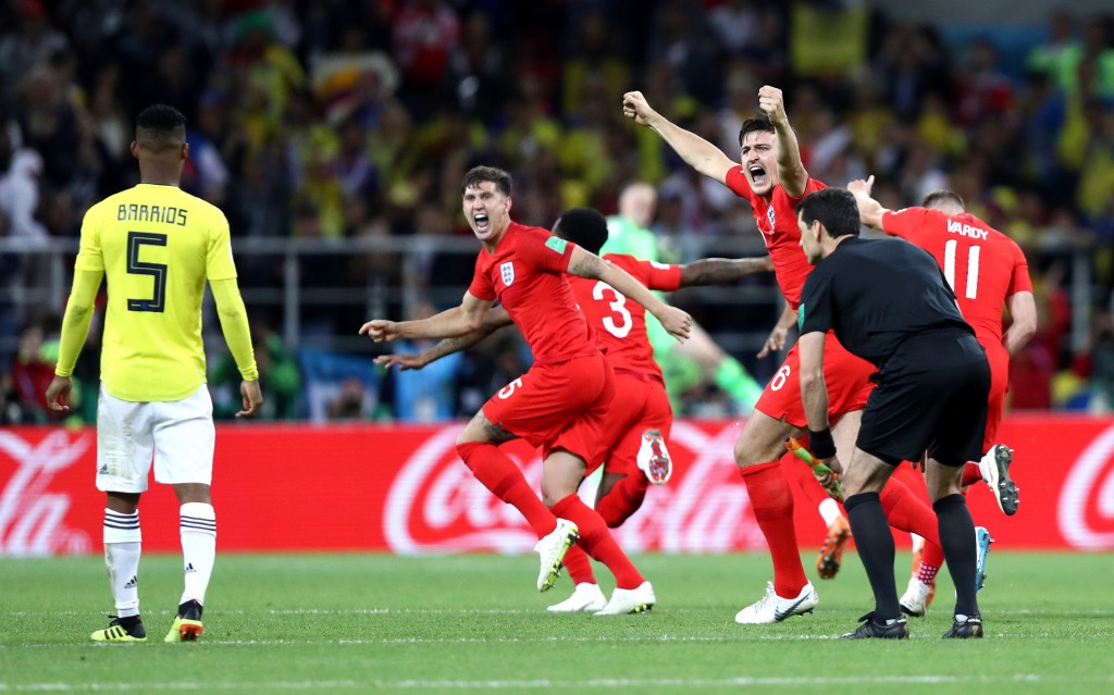 MOSCOW, RUSSIA - JULY 03: John Stones, ang3a and Harry Maguire of England celebrate victory during the 2018 FIFA World Cup Russia Round of 16 match between Colombia and England at Spartak Stadium on July 3, 2018 in Moscow, Russia. (Photo by Ryan Pierse/Getty Images)