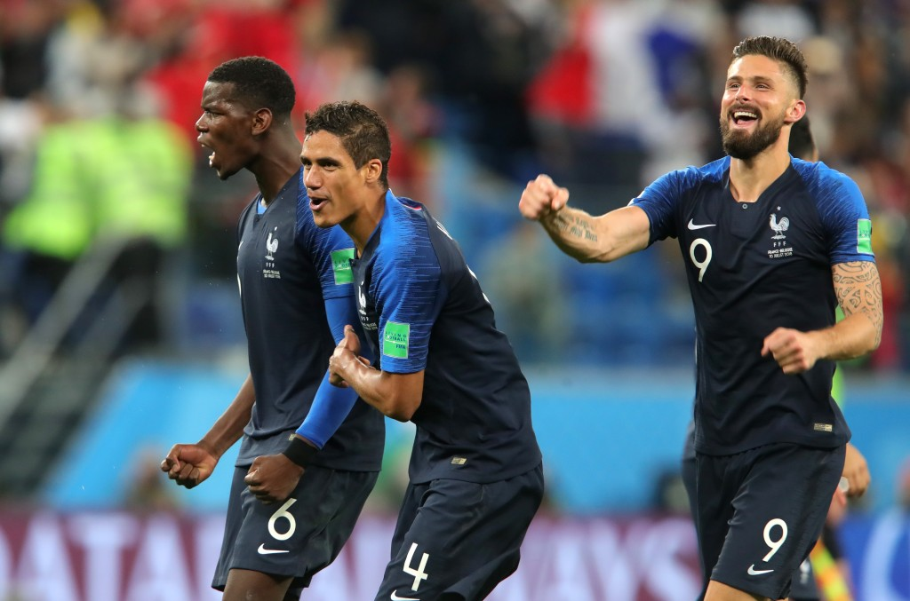 SAINT PETERSBURG, RUSSIA - JULY 10: Paul Pogba, Raphael Varane and Olivier Giroud of France celebrates victory following the 2018 FIFA World Cup Russia Semi Final match between Belgium and France at Saint Petersburg Stadium on July 10, 2018 in Saint Petersburg, Russia. (Photo by Alexander Hassenstein/Getty Images)