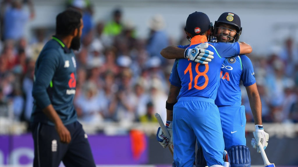 Rohit is congratulated by Kohli after getting to his hundred.