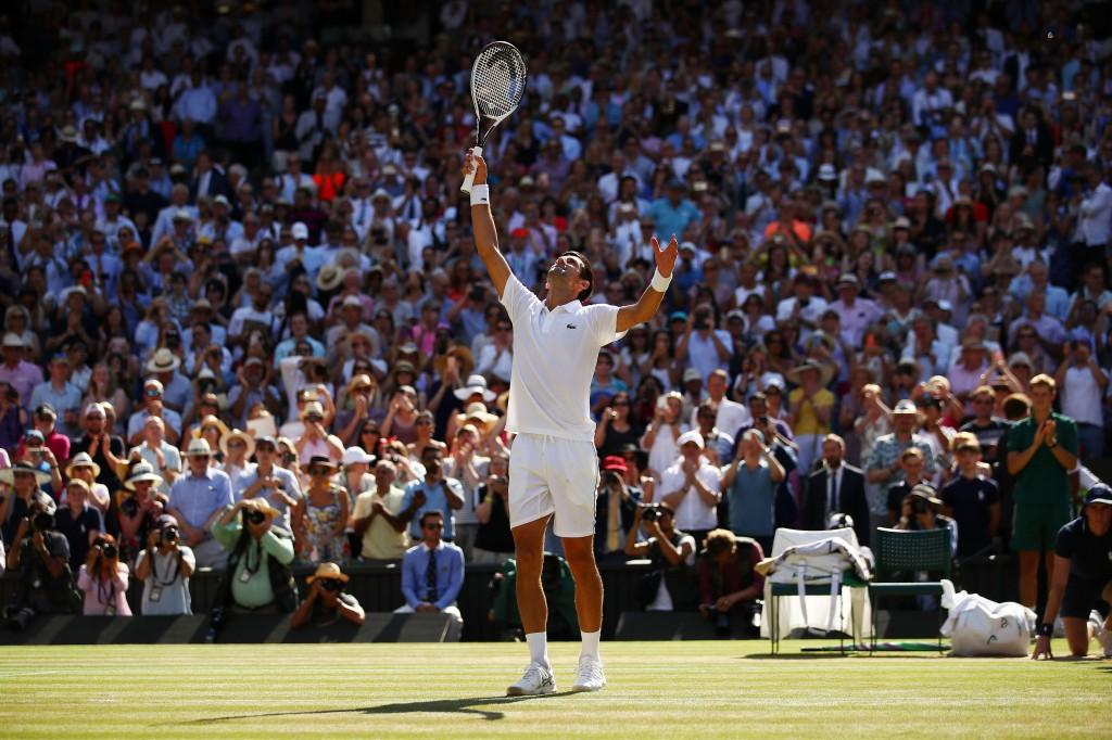Djokovic takes in the applause following his win.