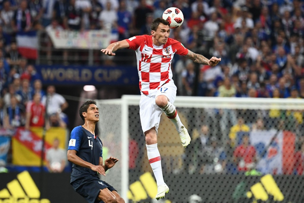 Croatia's forward Mario Mandzukic (R) vies with France's defender Raphael Varane during the Russia 2018 World Cup final football match between France and Croatia at the Luzhniki Stadium in Moscow on July 15, 2018. (Photo by FRANCK FIFE / AFP) / RESTRICTED TO EDITORIAL USE - NO MOBILE PUSH ALERTS/DOWNLOADS (Photo credit should read FRANCK FIFE/AFP/Getty Images)