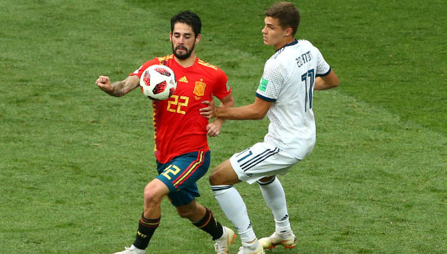 Isco of Spain is challenged by Daler Kuziaev
