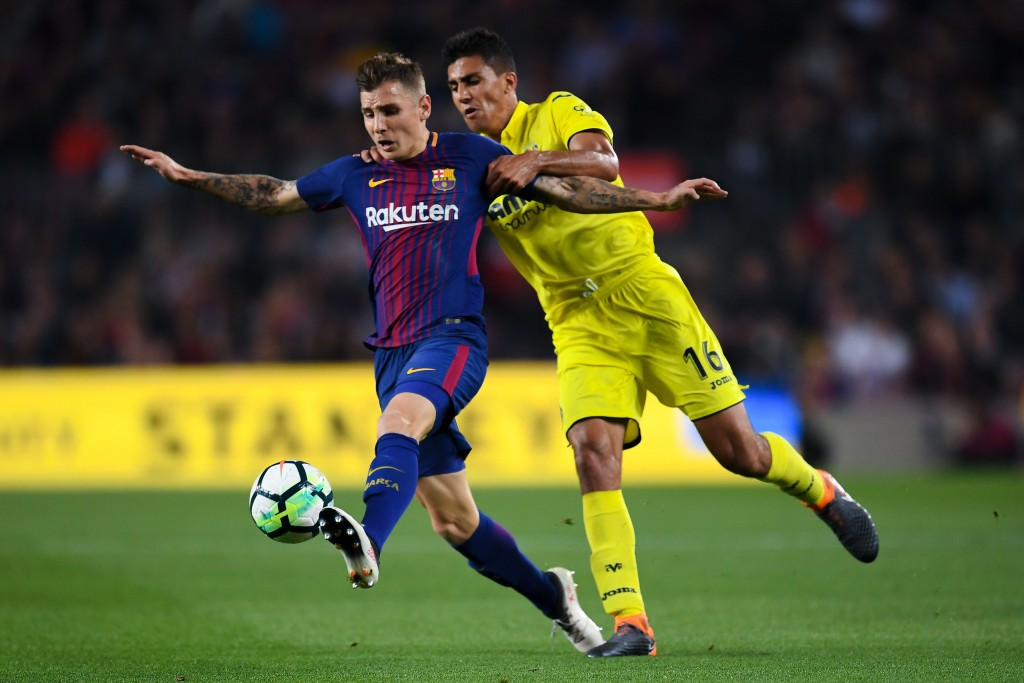 BARCELONA, SPAIN - MAY 09: Lucas Digne of FC Barcelona competes for the ball with Rodri Hernandez of Villarreal CF during the La Liga match between FC Barcelona and Villarreal at Camp Nou on May 9, 2018 in Barcelona, Spain. (Photo by David Ramos/Getty Images)