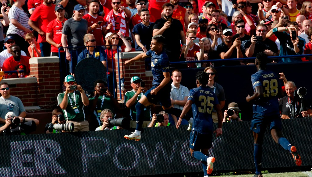 Pereira celebrates after his stunning free-kick against Liverpool in pre-season.