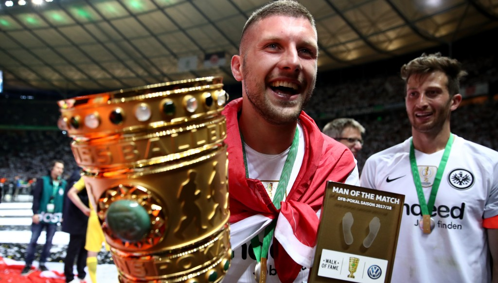 Ante Rebic with the DFB Pokal trophy and his man of the match award after scoring two goals in Frankfurt's 3-1 win over Bayern Munich in the final.