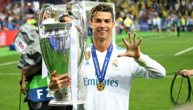 Ronaldo of Real Madrid lifts The UEFA Champions League trophy