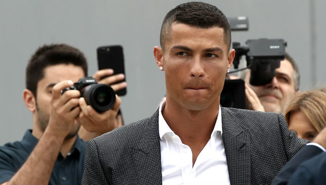 Ronaldo surrounded by photographs