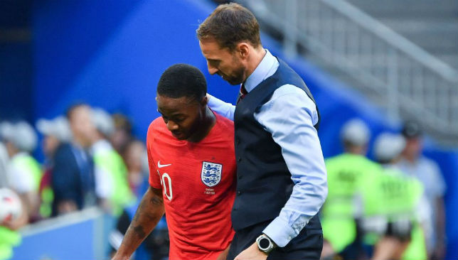 Southgate greets England's forward Raheem Sterling