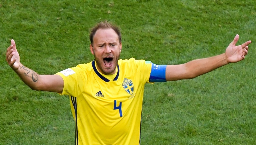Sweden captain Andreas Granqvist celebrates after the round of 16 victory over Switzerland