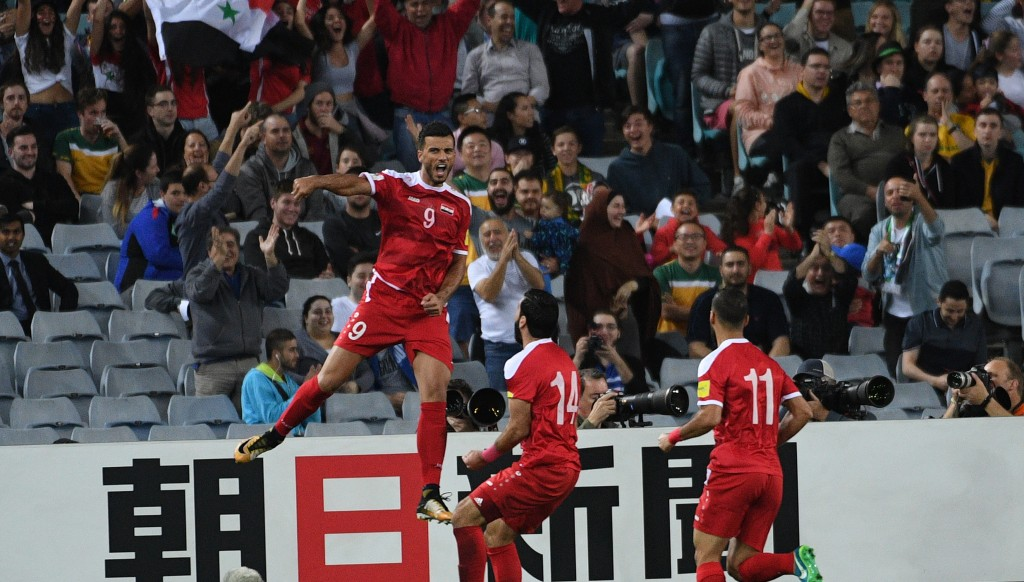 Omar Al Somah celebrates giving Syria the lead against Australia in Sydney in their World Cup second-leg play-off encounter.