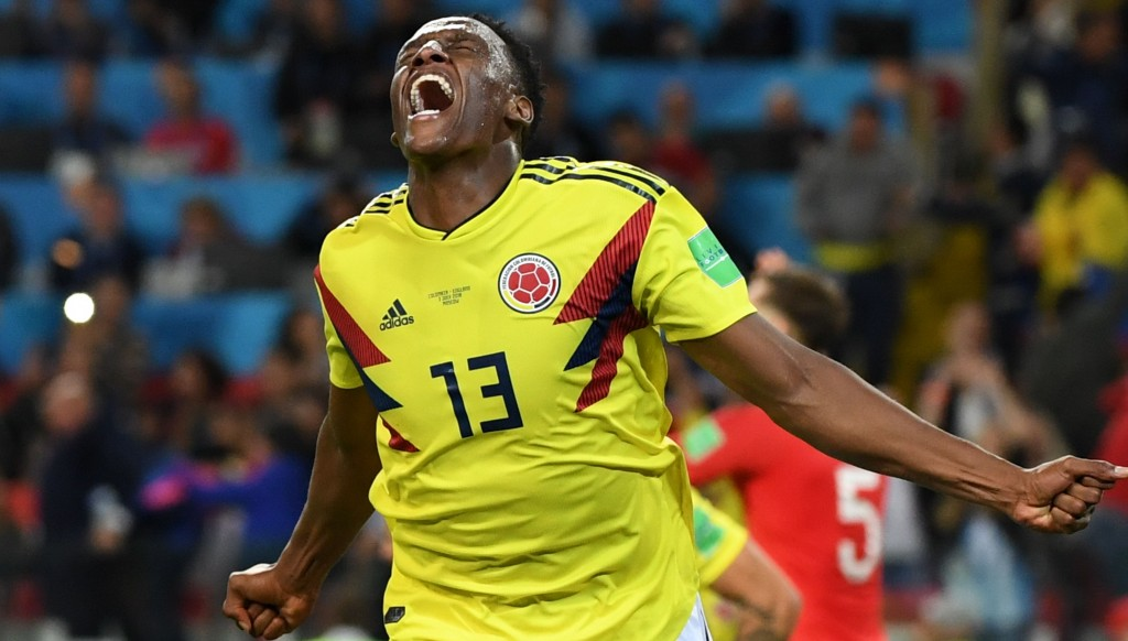 Yerry Mina celebrates after scoring for Colombia