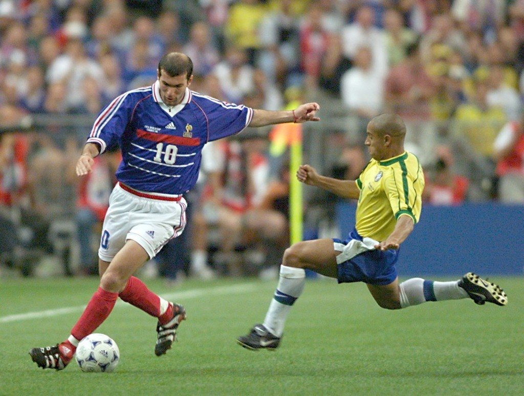 French Zinedine Zidane is challenged by Brazilian