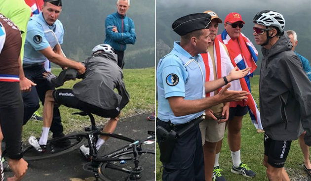 Froome is knocked off his bike by a French policeman (Photo Credit: Albert Secall).