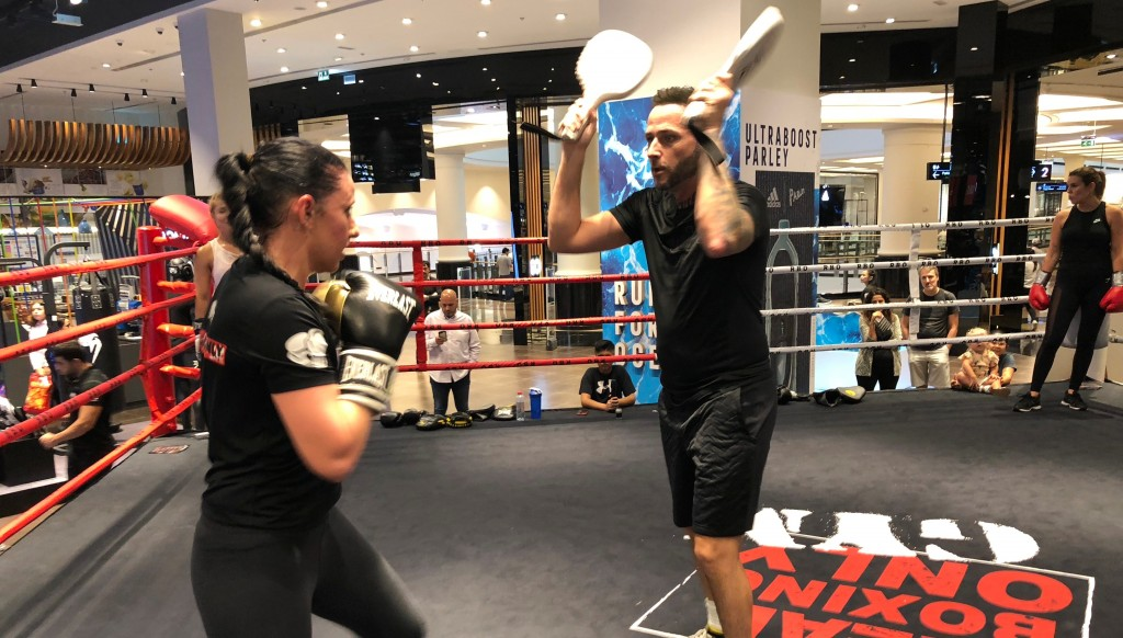 On the pads: Boxers and trainers held special work outs