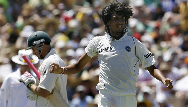 India's Ishant Sharma (R) celebrates the