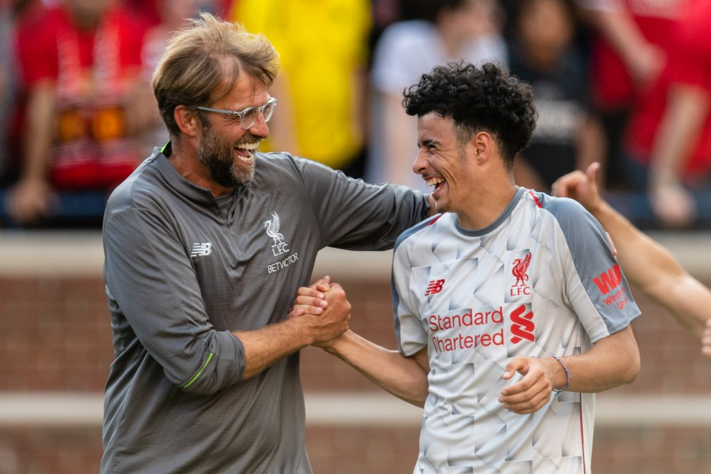 Jurgen Klopp celebrates with Curtis Jones