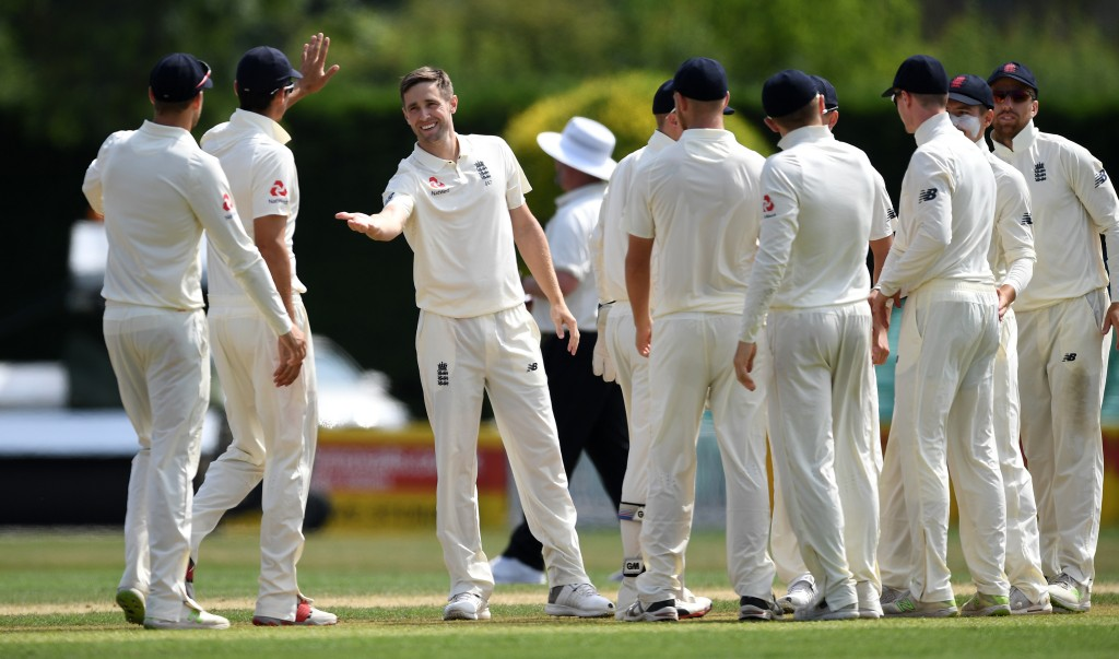 WORCESTER, ENGLAND - JULY 19: Chris Woakes of England Lions celebrates with teammates after dismissing Karun Nair of India A during the tour match between England Lions and India A at New Road on July 19, 2018 in Worcester, England. (Photo by Gareth Copley/Getty Images)