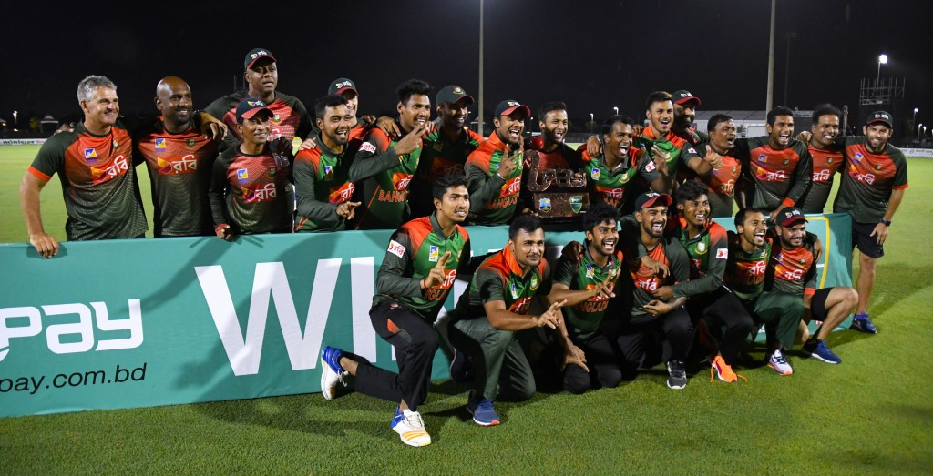 Bangladesh's players pose with the trophy after winning the 3rd and final T20i match against West Indies at Central Broward Regional Park Stadium in Fort Lauderdale, Florida, on August 5, 2018. (Photo by Randy Brooks / AFP) (Photo credit should read RANDY BROOKS/AFP/Getty Images)
