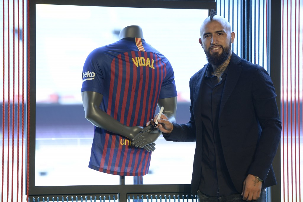 Barcelona's new player Chilean midfielder Arturo Vidal smiles during his official presentation at the Camp Nou stadium in Barcelona on August 6, 2018. (Photo by Josep LAGO / AFP) (Photo credit should read JOSEP LAGO/AFP/Getty Images)