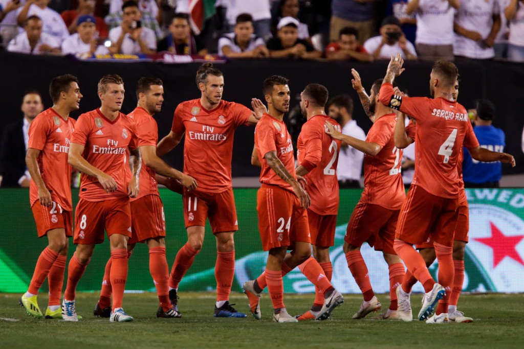 Real Madrid's Welsh forward Gareth Bale celebrates his goal with his teammates against AS Roma during their 2018 International Champions Cup at the MetLife stadium on August 07, 2018, in East Rutherford, NJ. (Photo by EDUARDO MUNOZ ALVAREZ / AFP) (Photo credit should read EDUARDO MUNOZ ALVAREZ/AFP/Getty Images)