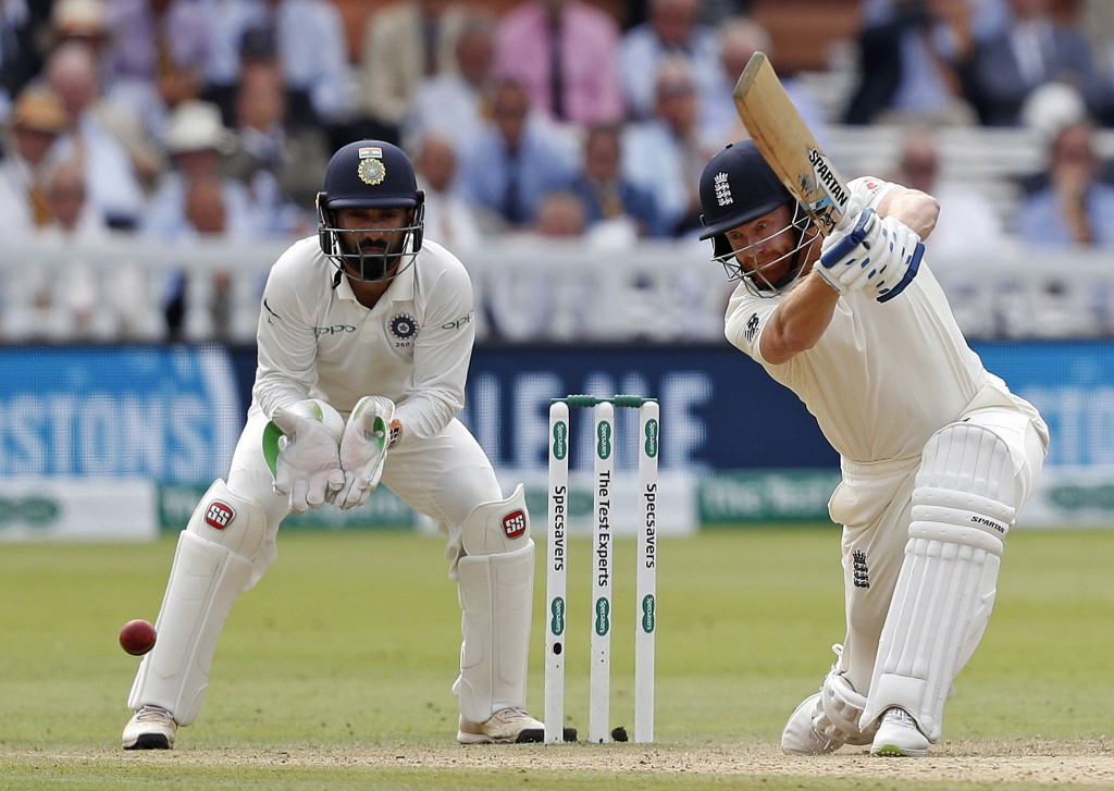 England's Jonny Bairstow (R) plays a shot on the third day of the second Test cricket match between England and India at Lord's Cricket Ground in London on August 11, 2018. (Photo by ADRIAN DENNIS / AFP) / RESTRICTED TO EDITORIAL USE. NO ASSOCIATION WITH DIRECT COMPETITOR OF SPONSOR, PARTNER, OR SUPPLIER OF THE ECB (Photo credit should read ADRIAN DENNIS/AFP/Getty Images)