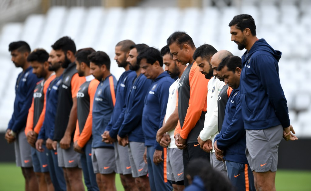 The team and staff held a minute's silence before the session.