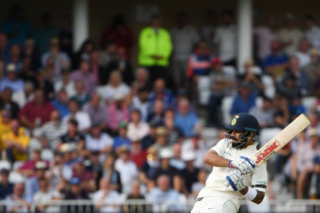 India's captain Virat Kohli plays a shot during the first day of the third Test cricket match between England and India at Trent Bridge in Nottingham, central England on August 18, 2018. (Photo by Paul ELLIS / AFP) / RESTRICTED TO EDITORIAL USE. NO ASSOCIATION WITH DIRECT COMPETITOR OF SPONSOR, PARTNER, OR SUPPLIER OF THE ECB (Photo credit should read PAUL ELLIS/AFP/Getty Images)