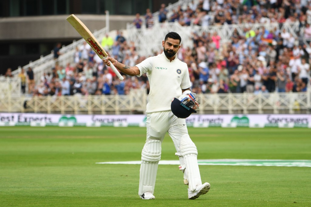 India's captain Virat Kohli salutes the crowd as he leaves the pitch after getting out lbw for 103 runs during the third day of the third Test cricket match between England and India at Trent Bridge in Nottingham, central England on August 20, 2018. (Photo by Paul ELLIS / AFP) / RESTRICTED TO EDITORIAL USE. NO ASSOCIATION WITH DIRECT COMPETITOR OF SPONSOR, PARTNER, OR SUPPLIER OF THE ECB (Photo credit should read PAUL ELLIS/AFP/Getty Images)