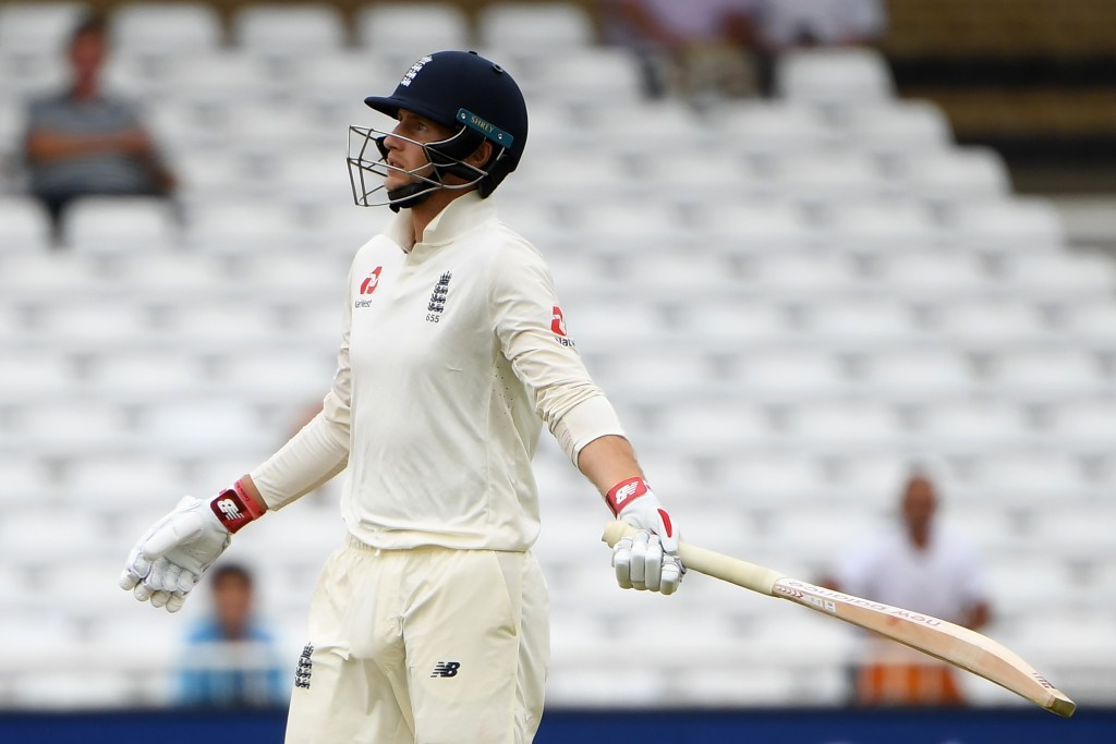 England's Joe Root leaves the pitch after losing his wicket for 13 during the fourth day of the third Test cricket match between England and India at Trent Bridge in Nottingham, central England on August 21, 2018. (Photo by Paul ELLIS / AFP) / RESTRICTED TO EDITORIAL USE. NO ASSOCIATION WITH DIRECT COMPETITOR OF SPONSOR, PARTNER, OR SUPPLIER OF THE ECB (Photo credit should read PAUL ELLIS/AFP/Getty Images)