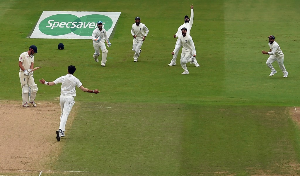 India's cricketers celebrate as England's Alastair Cook (L) loses his wicket for 17 during the fourth day of the third Test cricket match between England and India at Trent Bridge in Nottingham, central England on August 21, 2018. (Photo by Paul ELLIS / AFP) / RESTRICTED TO EDITORIAL USE. NO ASSOCIATION WITH DIRECT COMPETITOR OF SPONSOR, PARTNER, OR SUPPLIER OF THE ECB (Photo credit should read PAUL ELLIS/AFP/Getty Images)