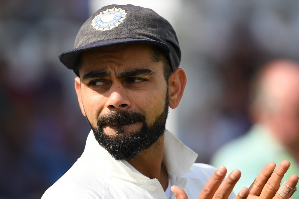 India's captain Virat Kohli is interviewed after winning the third Test cricket match between England and India at Trent Bridge in Nottingham, central England on August 22, 2018. (Photo by Paul ELLIS / AFP) / RESTRICTED TO EDITORIAL USE. NO ASSOCIATION WITH DIRECT COMPETITOR OF SPONSOR, PARTNER, OR SUPPLIER OF THE ECB (Photo credit should read PAUL ELLIS/AFP/Getty Images)